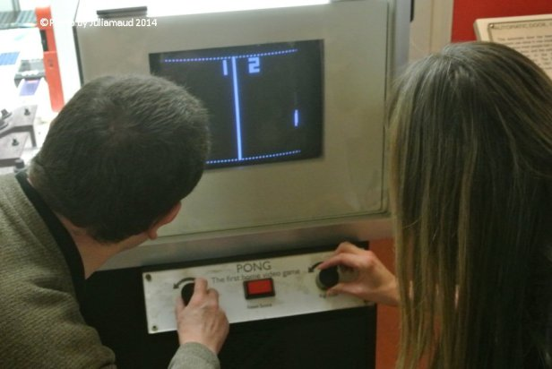 Treasure hunters playing the original Pong Game during the Secrets and Mystery Treasure Hunt at the Science Museum