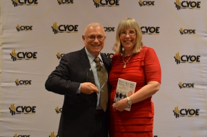 Raymond Aaron presents award to Catherine Skeggs
