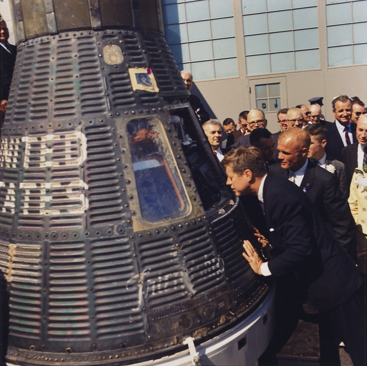 https://commons.wikimedia.org/wiki/File:JFK_inspects_Mercury_capsule,_23_February_1962.jpg