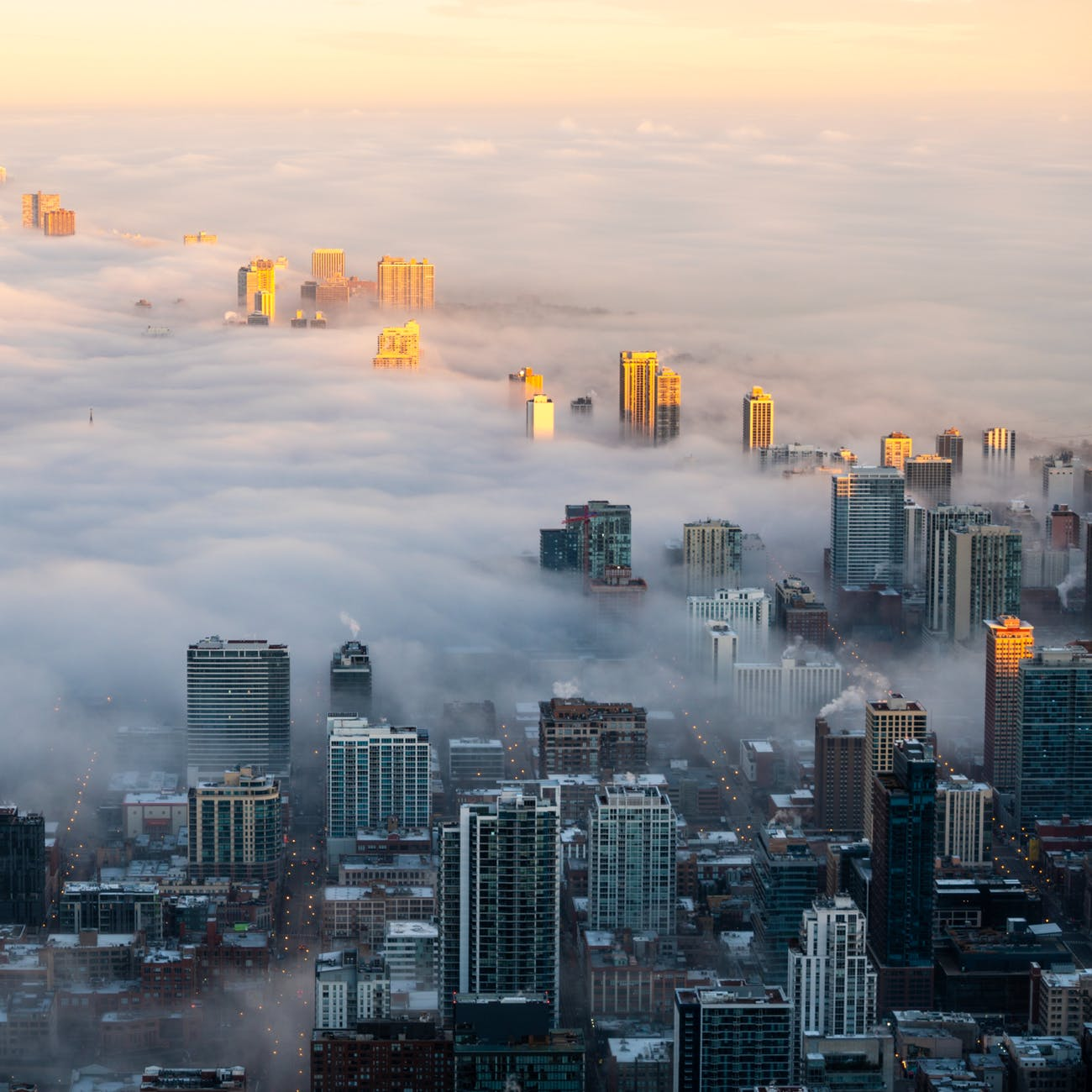 photo of cityscape covered in fog